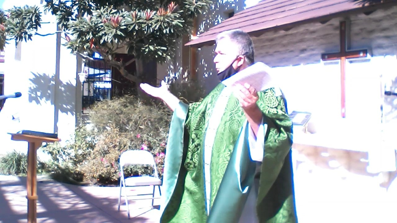 Father Carlos preaching at our courtyard Mass